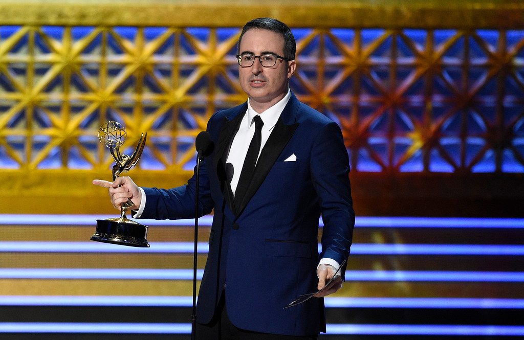 """. John Oliver accepts the award for outstanding writing for a variety series for \""""Last Week Tonight with John Oliver\"""" at the 69th Primetime Emmy Awards on Sunday, Sept. 17, 2017, at the Microsoft Theater in Los Angeles. (Photo by Chris Pizzello/Invision/AP)"""
