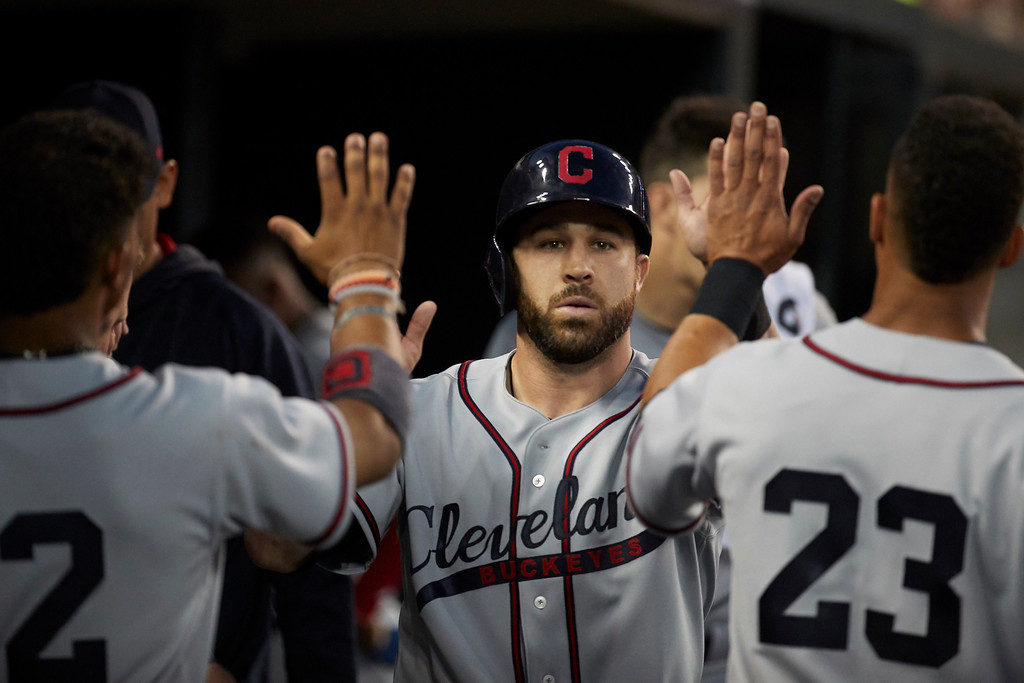 . Cleveland Indians Jason Kipnis is congratulated by teammates after scoring against the Detroit Tigers during the sixth inning in the second baseball game of a doubleheader in Detroit, Saturday, July 1, 2017. (AP Photo/Rick Osentoski)