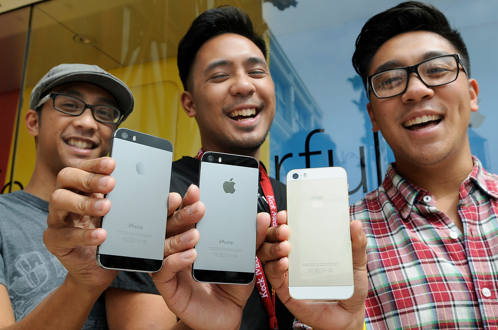 . The Fernandez brothers, all from Glendale, went to the Apple Store at the Americana at Brand to pick up their new iPhone 5s. Glendale, CA. 9/20/2013. photo by (John McCoy/Los Angeles Daily News)