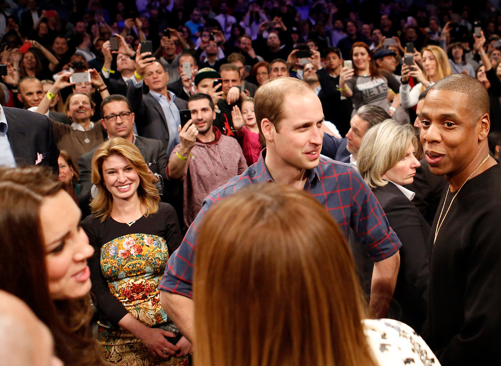 . Britain\'s Prince William, second from right, talks with rapper and entrepreneur Jay-Z , far right, as Kate, left, the Duchess of Cambridge, chats with Jay Z\'s wife, entertainer Beyonce, foreground center, during an NBA basketball game between the Cleveland Cavaliers and the Brooklyn Nets at the Barclays Center in New York, Monday, Dec. 8, 2014. (AP Photo/Kathy Willens)