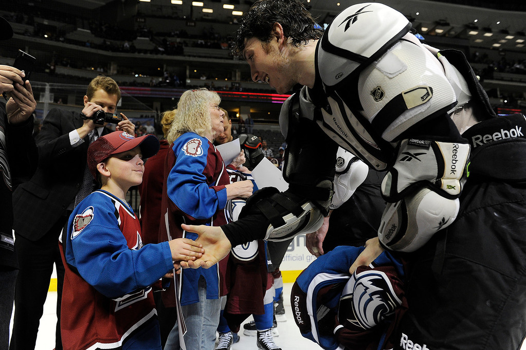 . Nathan Truax, 8, of Littleton shakes Matt Duchene (9) of the Colorado Avalanche\'s hand before during the Sweaters Off Our Backs promotion following the third period on Saturday, April 27, 2012 at Pepsi Center. Seth A. McConnell, The Denver Post