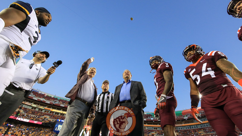 Everyone watches as Frank Beamer tosses the coin up into the air. (Mark Umansky/TheKeyPlay.com)