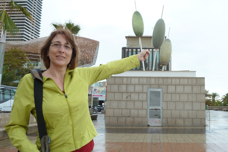 Along the beach in Barcelona, Karen makes a grab for a martini olive.