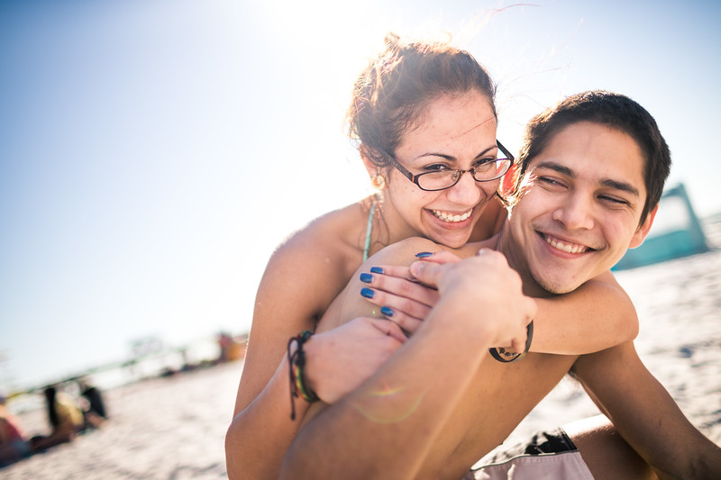 Portrait of a young happy couple hugging on the beach.