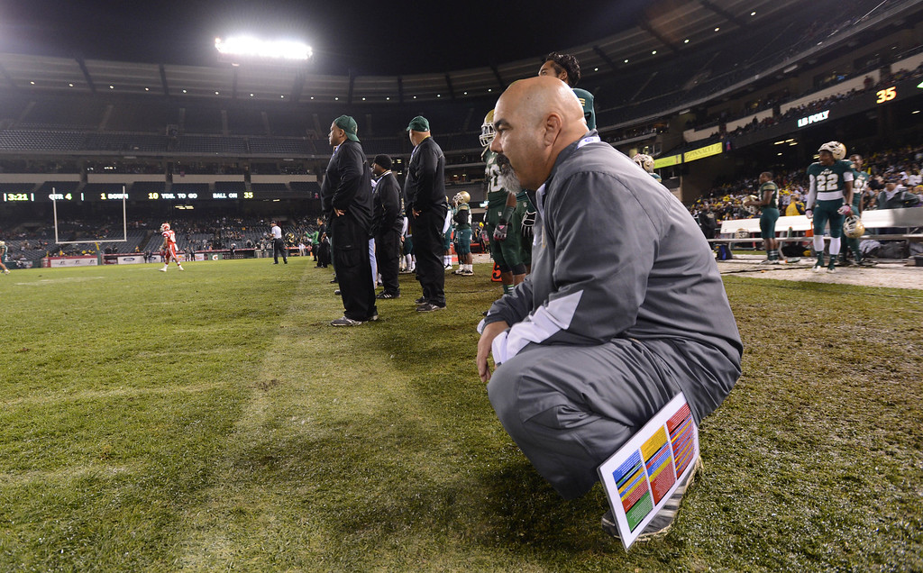 . Anaheim, Calif., --12-01-12 - Long Beach Poly\' head coach Raul Lara in the final minuets before his team defeated Mater Dei 35-17 for the CIF-SS Pac-5 Division championship, at Anaheim Stadium.   Stephen Carr/  LANG