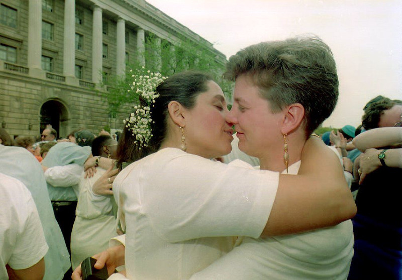. WASHINGTON, DC - APRIL 24:  Wendy Benner-Leon (R) and Terri Leon-Benner (L), from Boston, embrace 24 April 1993 after exchanging wedding vows at an Interfaith Ceremony of Commitment in front of the Internal Revenue Service Building. The gay and lesbian wedding ceremony, which included several couples, was a demonstration for same-sex couples\' rights under U.S. tax law. JENNIFER LAW/AFP/Getty Images