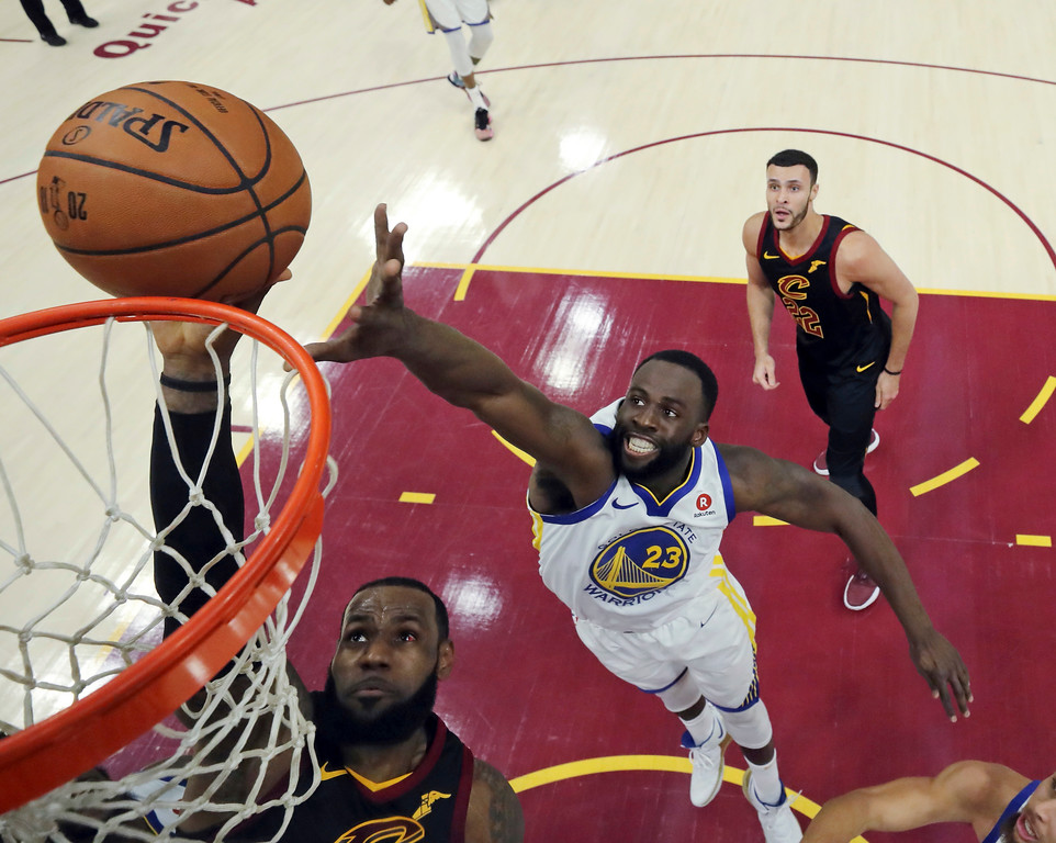 . Cleveland Cavaliers\' LeBron James shoots as Golden State Warriors\' Draymond Green defends during the first half of Game 3 of basketball\'s NBA Finals, Wednesday, June 6, 2018, in Cleveland. (Gregory Shamus/Pool Photo via AP)