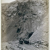 Title: Open cut in the great Homestake mine, at Lead City, Dak.<br /> Distant view of mine entrance; four men posed on or near three mining cars on tracks. 1888.<br /> Repository: Library of Congress Prints and Photographs Division Washington, D.C. 20540