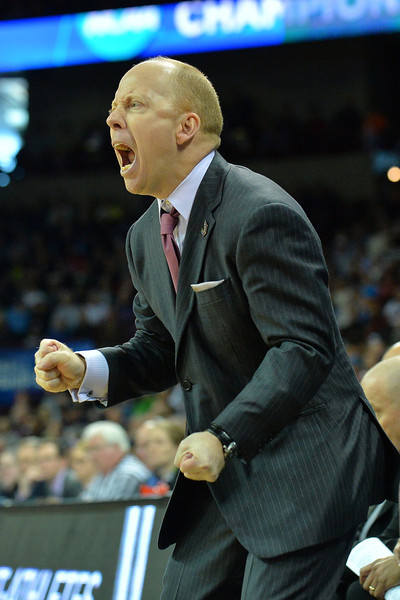 March 20, 2014: Cincinnati Bearcats head coach Mick Cronin yells instructions to his team during a second round game of the NCAA Division I Men's Basketball Championship between the 5-seed Cincinnati Bearcats and the 12-seed Harvard Crimson at Spokane Arena in Spokane, Wash. Harvard defeated Cincinnati 61-57.