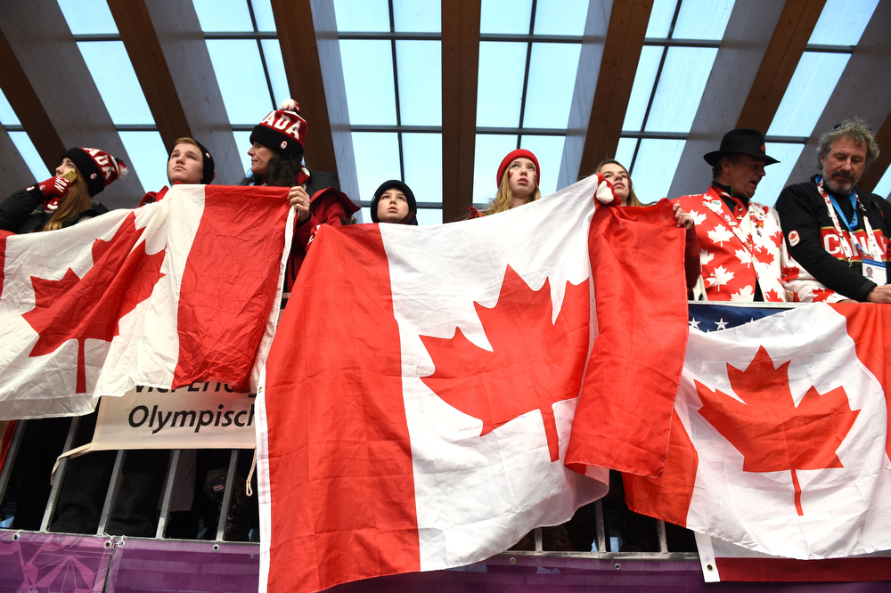 . Canadian Luge Doubles fans await the start of Run 1 at the Sanki Sliding Center during the Sochi Winter Olympics on February 12, 2014. (LEON NEAL/AFP/Getty Images)