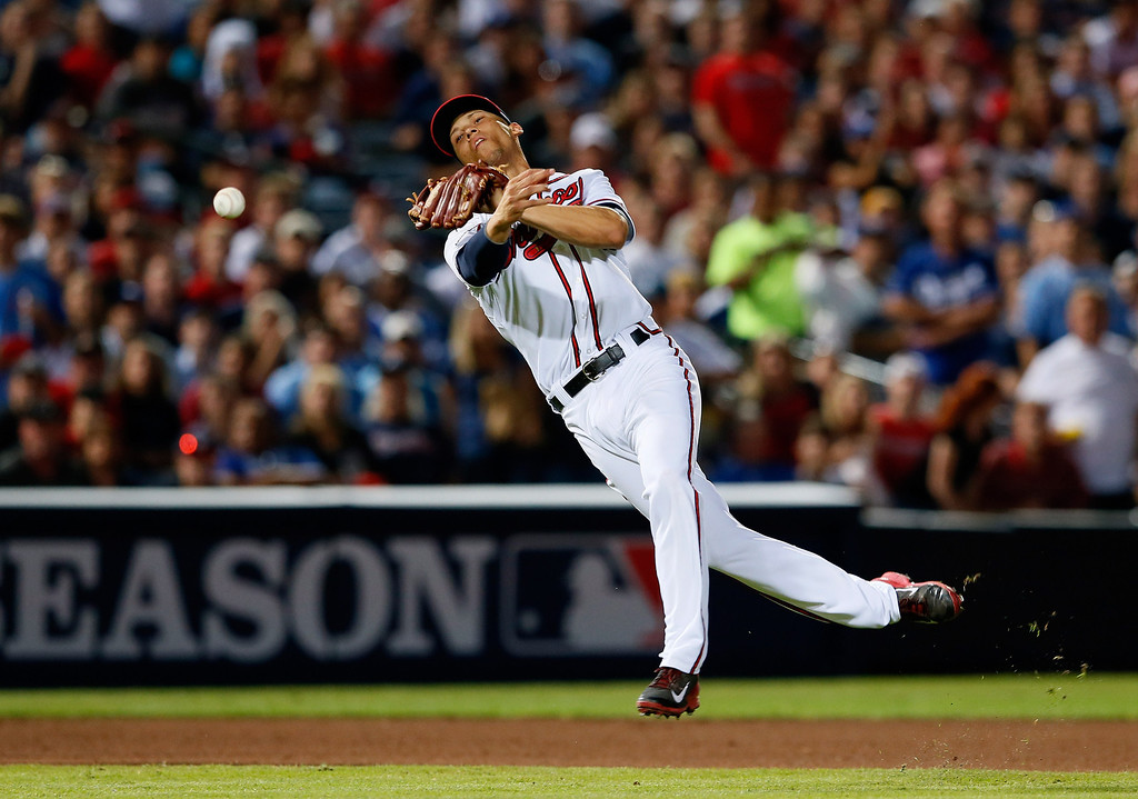 . ATLANTA, GA - OCTOBER 04: Andrelton Simmons #19 of the Atlanta Braves throws to first in the seventh inning against the Los Angeles Dodgers during Game Two of the National League Division Series at Turner Field on October 4, 2013 in Atlanta, Georgia.  (Photo by Kevin C. Cox/Getty Images)