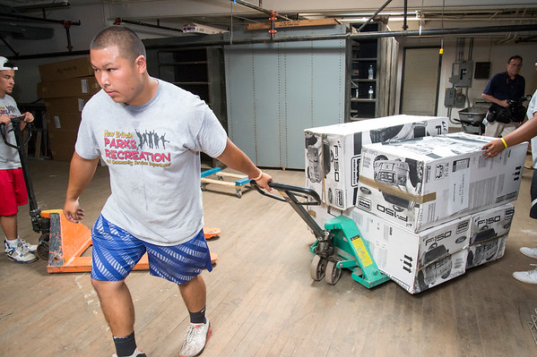 07/11/19 Wesley Bunnell | Staff Tyler Ounthongdy, a New Britain Parks & Rec employee, pulls a pallet of toy cars inside of a warehouse at 1 Hartford Square on Thursday morning. Approximately 300 toy cars were donated and delivered by Fisher-Price on to expand the Go Baby Go! program which is a learning project between New Britain High School and CCSU students in the technology fields. The program helps children with limited mobility by modifying toy cars for the exact needs of each child.