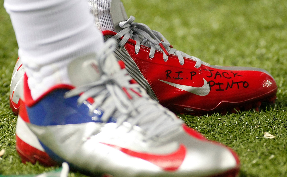 Description of . The shoe of New York Giants wide receiver Victor Cruz bears the words R.I.P. Jack Pinto in memory of one of the children killed in the Sandy Hook Elementary School shootings in Newtown, Connecticut Friday during play in the first half at their NFL football game in Atlanta, Georgia December 16, 2012.   REUTERS/Tami Chappell