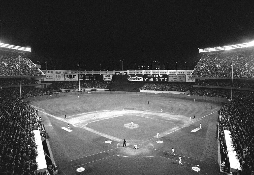 . Reggie Jackson of the New York Yankees heads for first to round the bases after knocking out his third consecutive homer in the eighth inning of the World Series game in New York, Oct. 18, 1977.  The Yanks beat the Dodgers, 8-4 to take the Series.  (AP Photo)