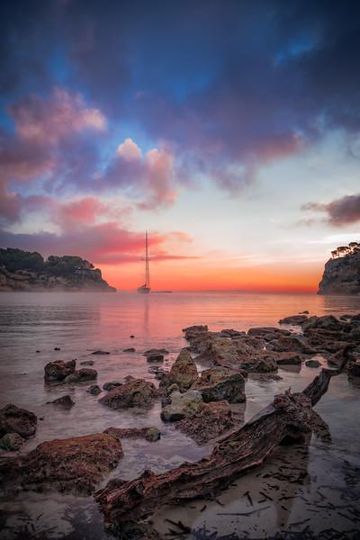 Cala Portals Vells with sailboat in Mallorca