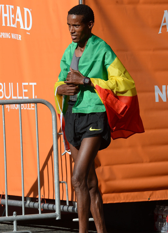 . 2014 ASICS LA Marathon men\'s winner Gebo Burka of Ethiopia, cafter he crossed the finish line in Santa Monica Calif, with a time of 2: 10: 37.   Sunday, March 9,  2014.   (Photo by Stephen Carr / Daily Breeze)