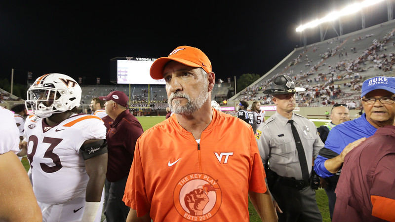 Virginia Tech defensive coordinator Bud Foster walks off the field following post-game handshakes. (Mark Umansky/TheKeyPlay.com)