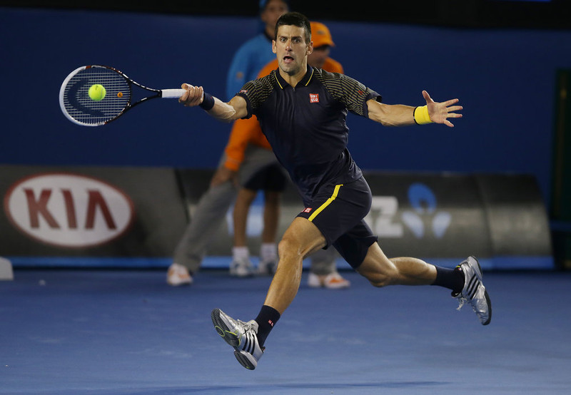 . Serbia\'s Novak Djokovic makes a forehand return to Britain\'s Andy Murray during the men\'s final at the Australian Open tennis championship in Melbourne, Australia, Sunday, Jan. 27, 2013. (AP Photo/Dita Alangkara)