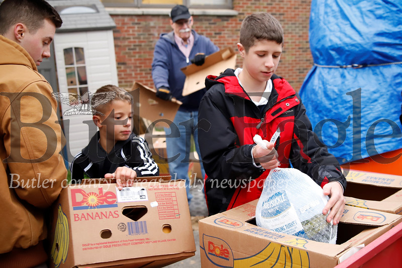 Seth Orday, 13 and his younger brother Evan, 8, drop off donated turkeys and thanksgiving supplies at  the Lighthouse Foundation Tuesday. Seb Foltz/Butler Eagle 11/19/19