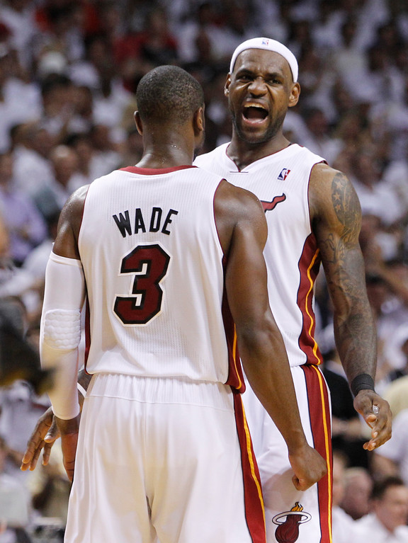 . Miami Heat\'s LeBron James and Dwyane Wade (3) celebrate their overtime win over the Chicago Bulls during Game 4 of the NBA Eastern Conference finals basketball series in Miami, Tuesday, May 24, 2011. The Heat defeated the Bulls 101-93.  (AP Photo/Lynne Sladky)