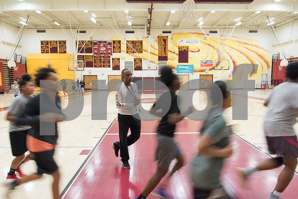 11/29/17 Wesley Bunnell | Staff Coach Mike Jones watches as the New Britain girls basketball team runs laps around the court at NBHS on Wednesday afternoon.