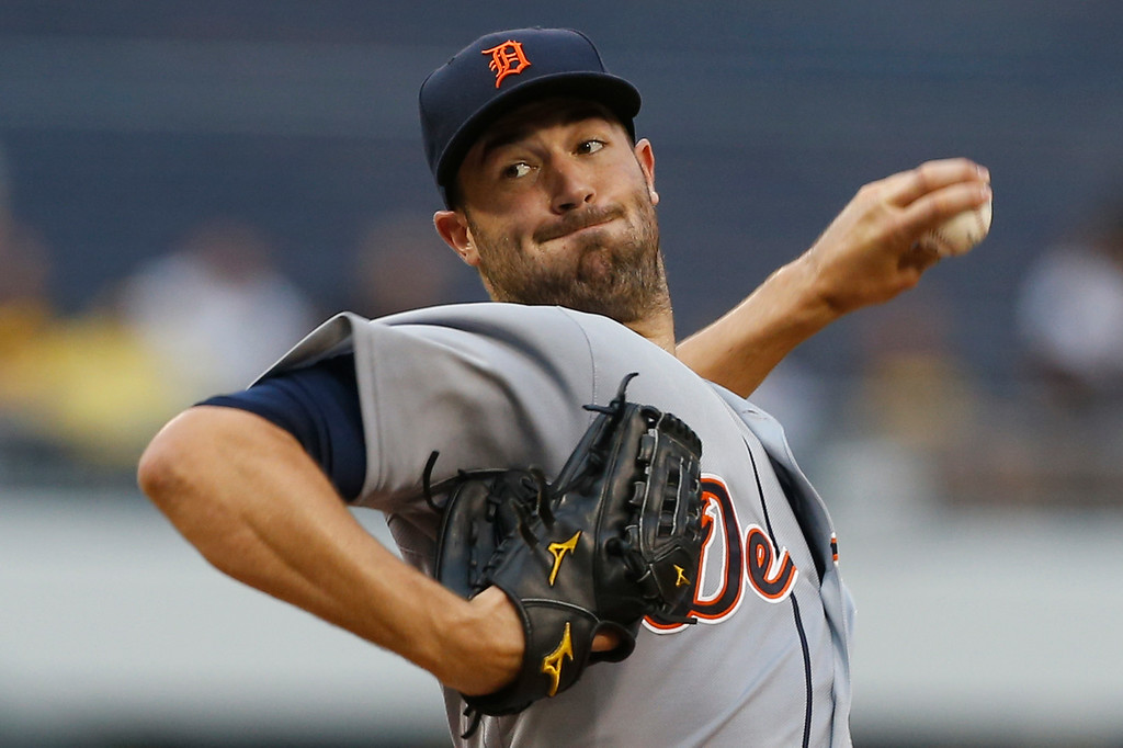 . Detroit Tigers starting pitcher Robbie Ray throws against the Pittsburgh Pirates in the first inning of the baseball game on Tuesday, Aug. 12, 2014, in Pittsburgh. (AP Photo/Keith Srakocic)
