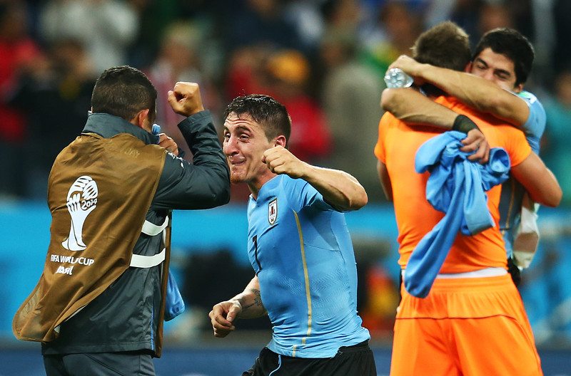. Cristian Rodriguez of Uruguay reacts with teammates after defeating England 2-1 during the 2014 FIFA World Cup Brazil Group D match between Uruguay and England at Arena de Sao Paulo on June 19, 2014 in Sao Paulo, Brazil.  (Photo by Julian Finney/Getty Images)