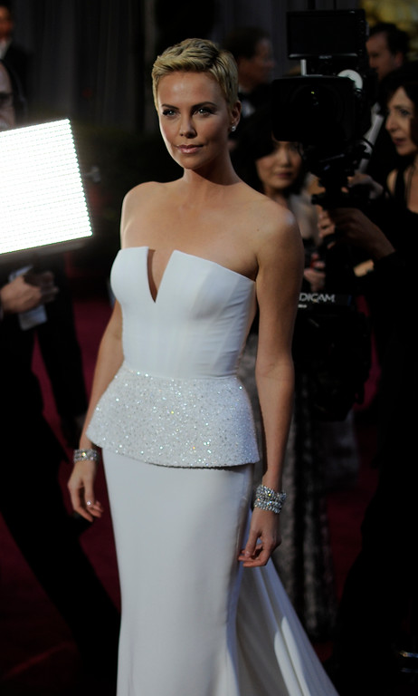 . Actress Charlize Theron arrives at the 85th Academy Awards at the Dolby Theatre in Los Angeles, California on Sunday Feb. 24, 2013 ( Hans Gutknecht, staff photographer)