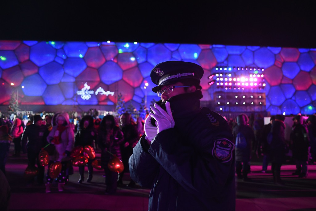 . A security guard patrols during a New Year\'s Eve countdown event outside the Beijing\'s National Stadium, Known as the Bird\'s Nest in Beijing on December 31,2014. Beijing is bidding to host the 2022 Winter Olympic Games, with a decision on the winning city to be made in July 2015.        AFP PHOTO / WANG ZHAOWANG ZHAO/AFP/Getty Images