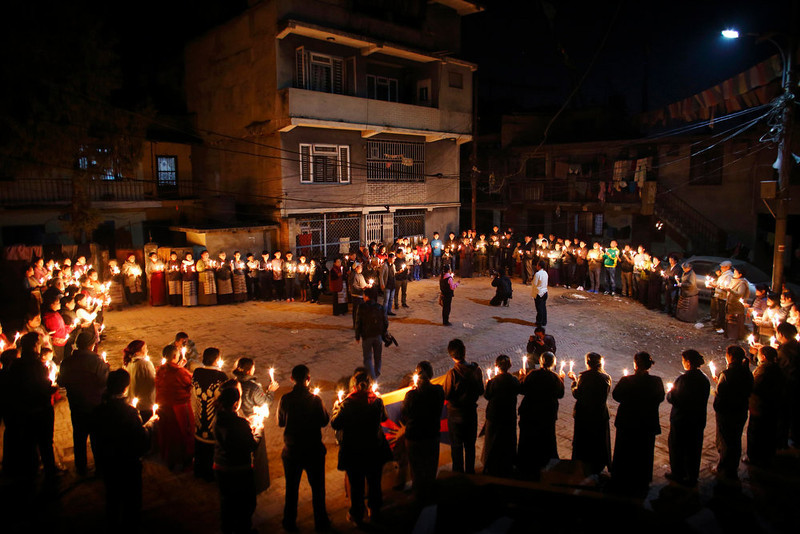 . Tibetans hold a candlelight vigil to show solidarity to Tibetans who have self-immolated, and to mark the 100th anniversary of the 1913 Tibetan Proclamation of Independence, at the Tibetan Refugee Camp in Lalitpur February 13, 2013. A Tibetan monk self-immolated on Wednesday at the premises of the Boudhanath Stupa in Kathmandu. REUTERS/Navesh Chitrakar