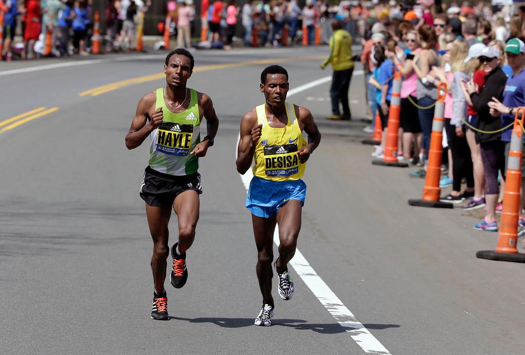 . Lemi Berhanu Hayle, left, and Lelisa Desisa, both of Ethiopia, run through Newtwon, Mass., during the 120th Boston Marathon on Monday, April 18, 2016. (AP Photo/Steven Senne)