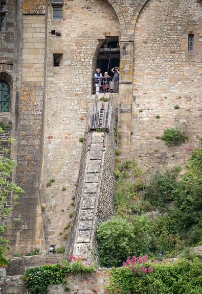 When the abbey was used as a prison, a wooden sledge on a buttress served to raise supplies.  The track is about four times longer than visible in this close-up.