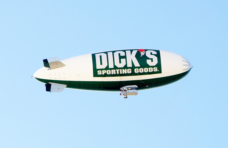 An advertising blimp sails overhead ...
