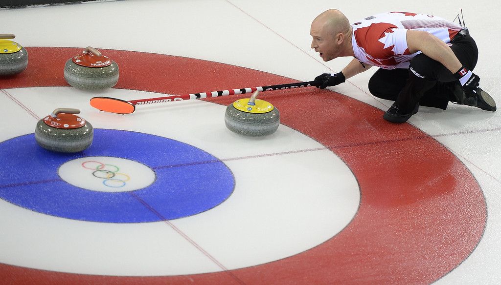 . Canada\'s Ryan Fry checks the direction of the stone during the 2014 Sochi winter olympics men\'s curling round robin session 1 match against Germany at the Ice Cube curling centre in Sochi on February 10, 2014. JUNG YEON-JE/AFP/Getty Images