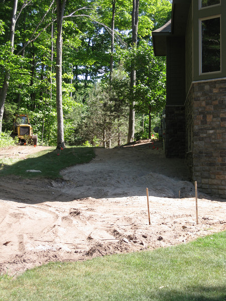 Side before steps and drip line rocks