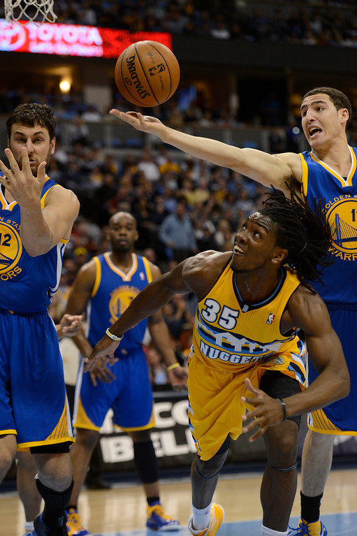 . DENVER, CO. - APRIL 23: Denver Nuggets small forward Kenneth Faried (35) battles with Golden State Warriors center Andrew Bogut (12) and Golden State Warriors shooting guard Klay Thompson (11) for a loose ball in the second quarter. The Denver Nuggets took on the Golden State Warriors in Game 2 of the Western Conference First Round Series at the Pepsi Center in Denver, Colo. on April 23, 2013. (Photo by John Leyba/The Denver Post)