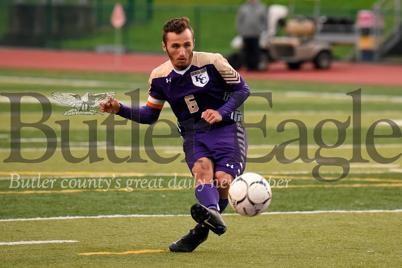 Karns City's Dakota King shoots a penalty kick against Harbor Creek Wednesday. King scored on the shot to put the Gremlins up 3-1 in the second half. Seb Foltz/Butler Eagle