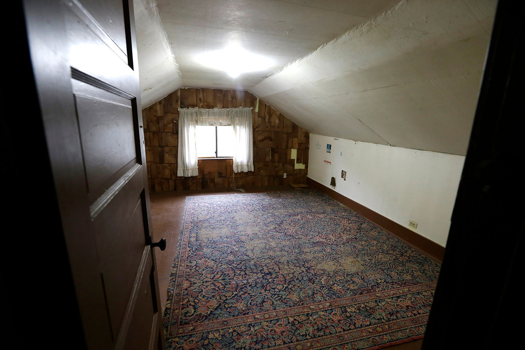 . In this photo taken Monday, Sept. 23, 2013, an attic bedroom used by Kurt Cobain, the late frontman of Nirvana, is said by realtors to still include the original rug from when he lived in his childhood home in Aberdeen, Wash. (AP Photo/Elaine Thompson)