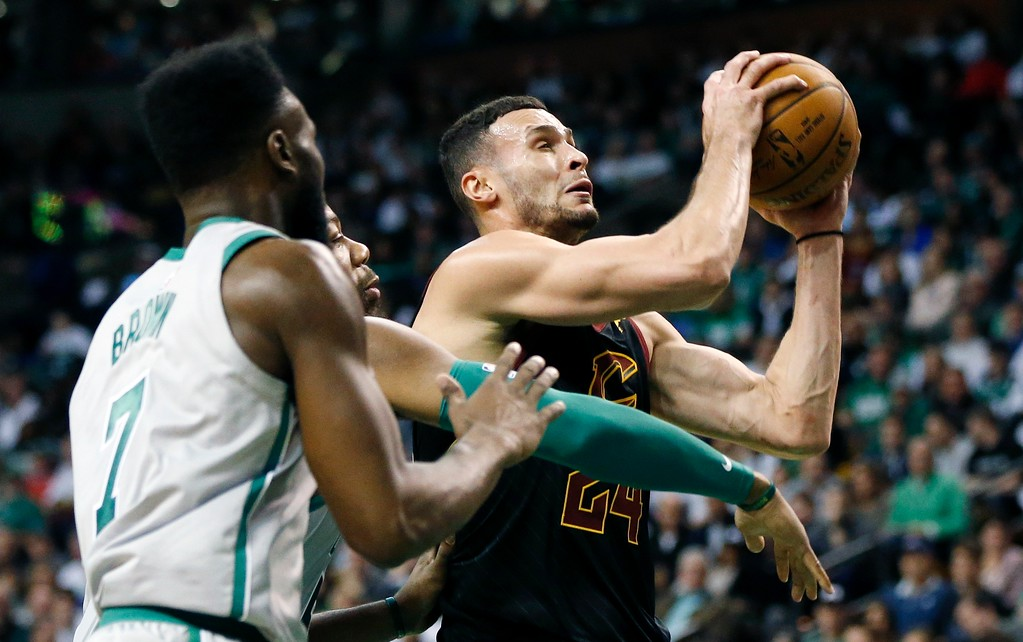 . Cleveland Cavaliers\' Larry Nance Jr. (24) drives for the basket against Boston Celtics\' Greg Monroe, behind left, and Jaylen Brown (7) during the fourth quarter of an NBA basketball game in Boston, Sunday, Feb. 11, 2018. (AP Photo/Michael Dwyer)