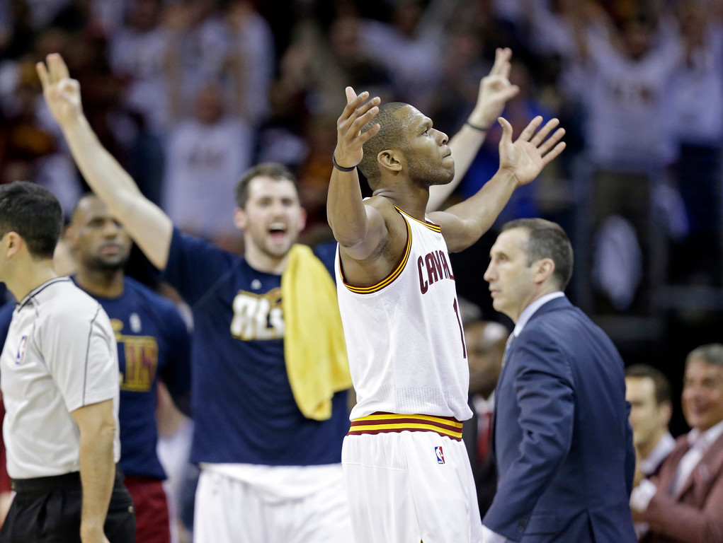 . Cleveland Cavaliers\' James Jones celebrates a shot in a first round NBA playoff basketball game against the Boston Celtics Sunday, April 19, 2015, in Cleveland. (AP Photo/Tony Dejak)