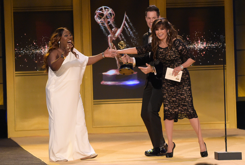 ". Sheryl Underwood, left, reacts as Marie Osmond, from right, and David Osmond present ""The Talk\"" with the award for outstanding entertainment talk show at the 45th annual Daytime Emmy Awards at the Pasadena Civic Center on Sunday, April 29, 2018, in Pasadena, Calif. (Photo by Richard Shotwell/Invision/AP)"