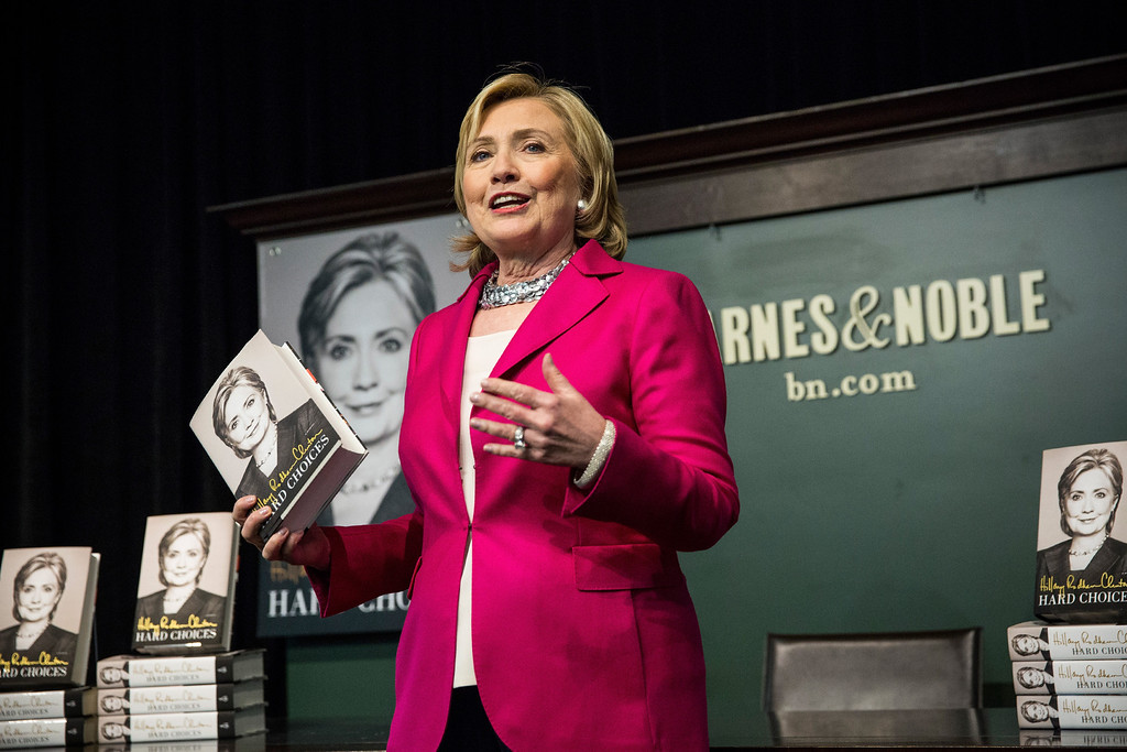 ". Former Secretary of State Hillary Clinton speaks to a crowd during a book signing for her new book, ""Hard Choices\"" at a Barnes & Noble on June 10, 2014 in New York City. Clinton has published the book in what many believe is the beginning of another bid for the presidency.  (Photo by Andrew Burton/Getty Images)"