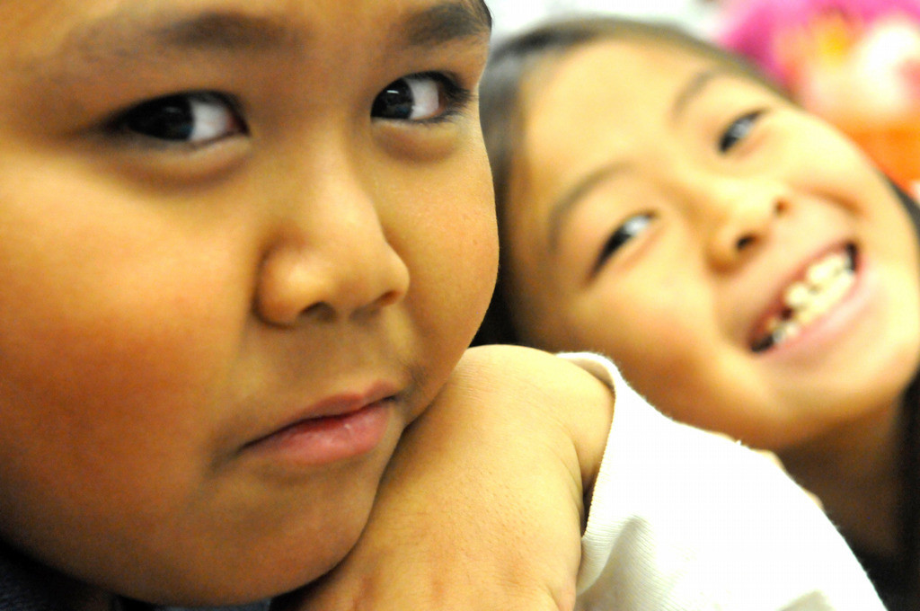 . Pals John Htoo, left and Naila Xiong look up for a moment from their work in Tara Kuehkwein\'s classroom at Frost Lake Elementary.  (Pioneer Press: John Doman)