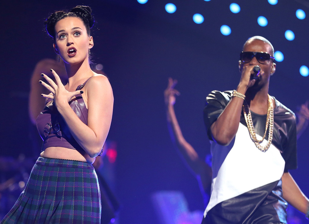 . Entertainer Katy Perry (L) and Juicy J performs onstage during the iHeartRadio Music Festival at the MGM Grand Garden Arena on September 20, 2013 in Las Vegas, Nevada.  (Photo by Christopher Polk/Getty Images for Clear Channel)
