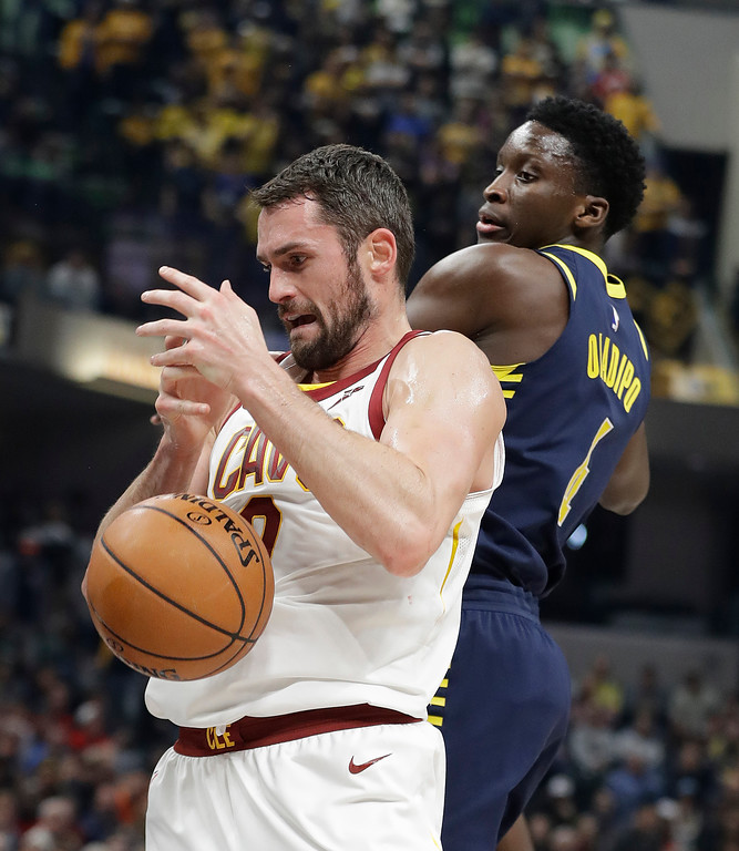 . Cleveland Cavaliers\' Kevin Love (0) is defended by Indiana Pacers\' Victor Oladipo during the first half of an NBA basketball game, Friday, Dec. 8, 2017, in Indianapolis. (AP Photo/Darron Cummings)
