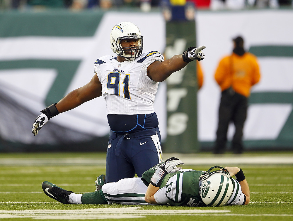 . Kendall Reyes #91 of the San Diego Chargers reacts after sacking quarterback Greg McElroy #14 of the New York Jets during the second half at MetLife Stadium on December 23, 2012 in East Rutherford, New Jersey. The Chargers defeated the Jets 27-17. (Photo by Rich Schultz /Getty Images)