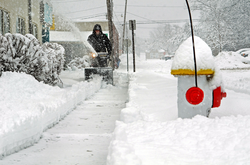 . Michael Hendricks clears snow from sidewalk on East Blaine Street in Lansdale.    Monday, February 3, 2014.  Photo by Geoff Patton