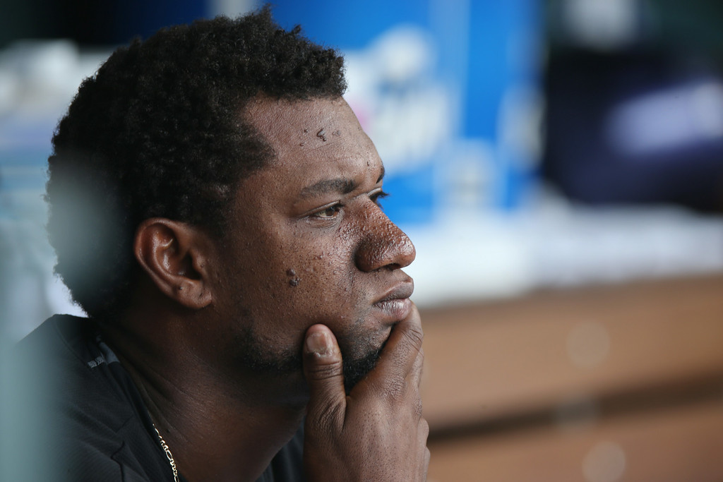 . Colorado Rockies starting pitcher Yohan Flande sits in the dugout after being pulled against the Chicago Cubs after the sixth inning of the Cubs\' 6-2 victory in a baseball game in Denver on Thursday, Aug. 7, 2014. (AP Photo/David Zalubowski)