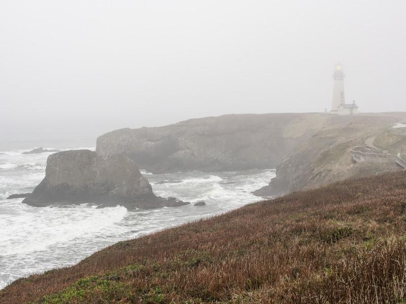 Oregon's Yaquina Head Lighthouse in Fog and Rain