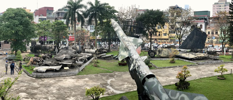 Around Christmas of 1972 the US sent waves of B52's over North Vietnam. A couple were shotdown. One lays strewn across a few blocks, including a portion in a small pond.